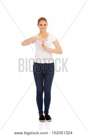 Young woman doing a break symbol