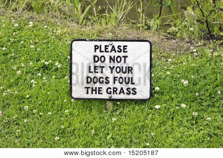 A photography of a sign in the grass
