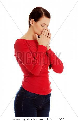 Young sneezing woman with sinus pain