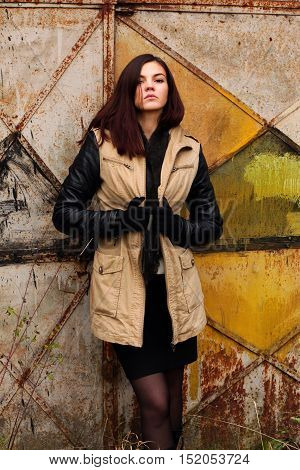 Photo of girl in warm winter jacket on art background