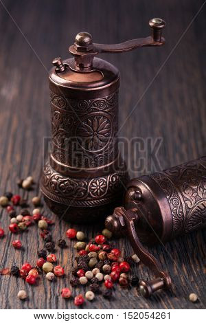 pepper grinders on a wooden table