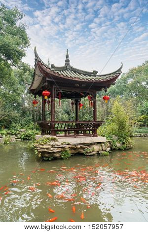 chinese ancient pavilion with golden fish