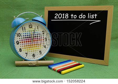 2018 New Year to do list written on a small blackboard.