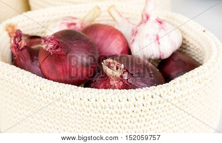 Red Onions In A Wicker Basket Close-up