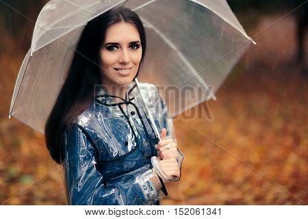Autumn Woman with Transparent Raincoat and Umbrella