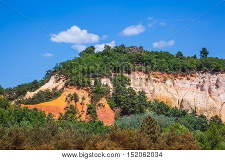 Languedoc - Roussillon, Provence, France. Reserve in mining ocher quarry. Orange and red picturesque hills