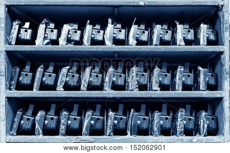 The taillights on the shelves of an automobile factory