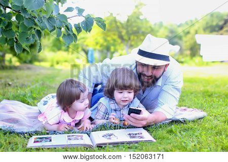 family outdoor lay on the grass in summer