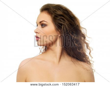 Beautiful topless woman with long curly hair
