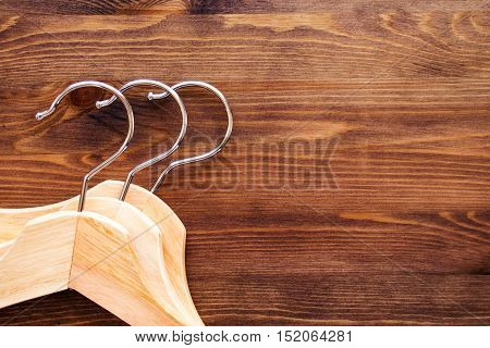 Wooden hangers for clothes on a wooden table