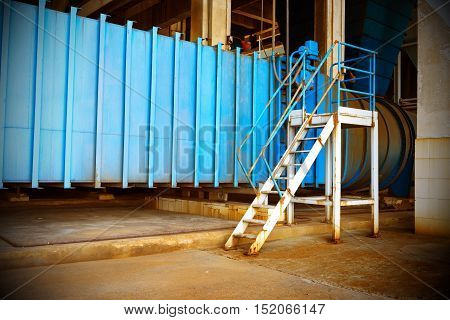 Thermal power plant workplace large pipes and metal stairs.