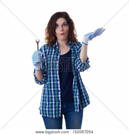 Young woman in casual clothes over white isolated background wrench tool, happy people and construction concept