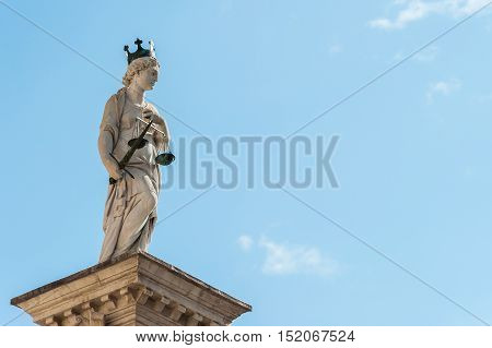 Statue of Justice on the background of the sky