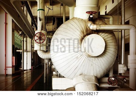 Large-scale thermal power plant piping and red inside the valve.
