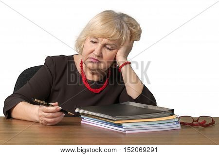Bored Old Woman Sitting behind Table with Head Resting on Hand - Isolated