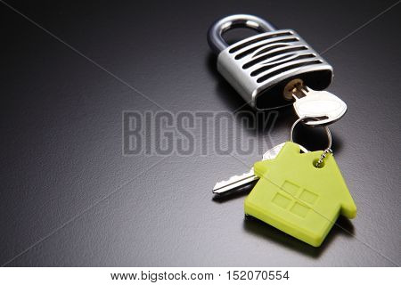house chain with green house shape unlock a padlock