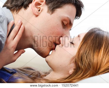 Attractive Couple Of Lovers Kissing Itself Lovingly On A Sofa