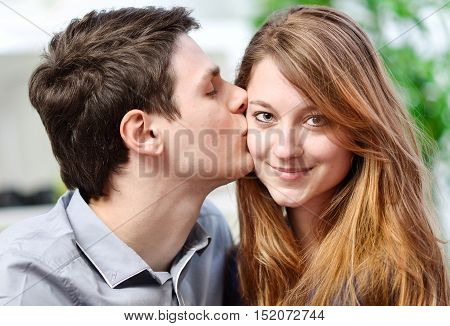 Handsome Young Man Embracing His Girlfriend With Love