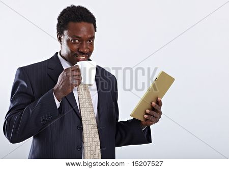 Businessman with cup and tablet pc