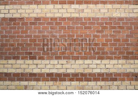 Plaster brick background with brown and beige