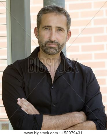 portrait of handsome man in his 40s wearing a black shirt