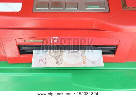 Machine payout of ATM and have Banknotes of Thai baht money payout.