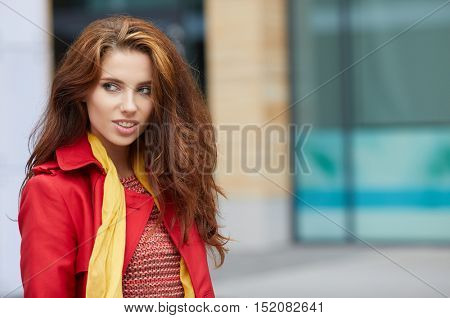 Gorgeous young beautiful woman in red coat