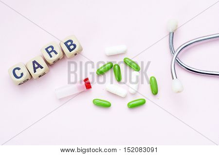 Pink background caption medical, pills and stethoscope