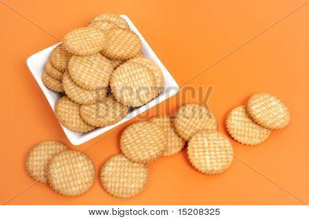 An image of some nice cracker on orange background