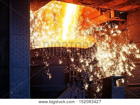 Liquid iron from ladle in the steelworks
