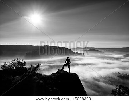 Man Silhouette On The Sharp Peak. Satisfy Hiker Enjoy View.