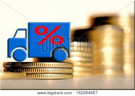Truck and red percent sign on a background of money. The concept of change of car prices .