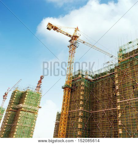 Scaffolding and cranes in modern construction sites