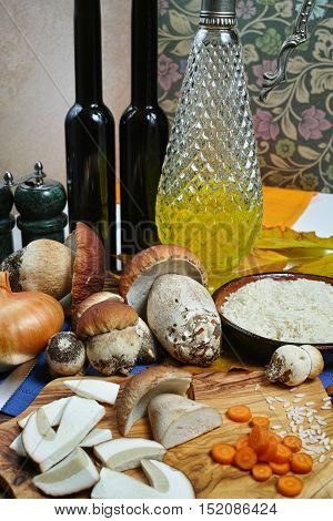Cooking risotto with wild mushrooms boletus with white wine