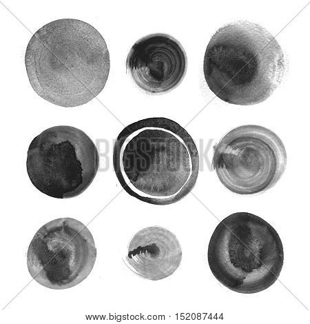 Collection of black watercolor round stains on white background