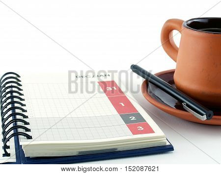 last day of December and first day of January on calendar diary page with coffee cup on white background, concept about the end and restart of time