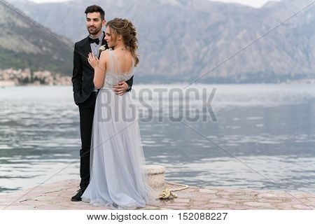 beautiful caucasian couple just married on the seashore