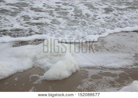 Sea foam. Waves. Storm on the ocean