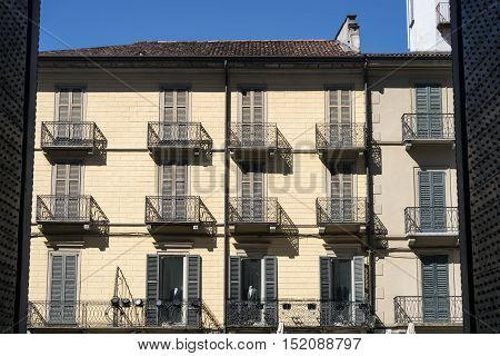 Como (Lombardy Italy): facade of hitoric palace seen from the interior of the cathedral