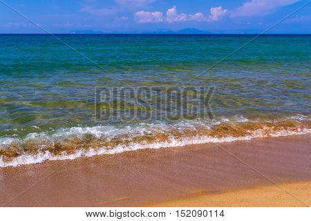 sea surf and wave on the sandy coast