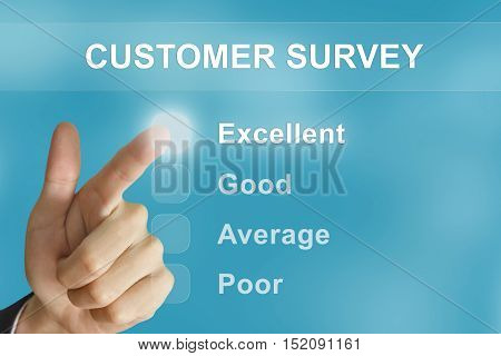business hand clicking customer survey button on screen