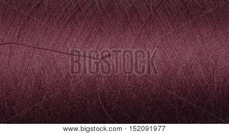 Background texture of industrial, purple silk thread.