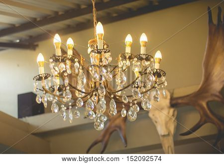 Home interiors Chandelier on ceiling. Vintage chandelier. Luxury chanderlier for home decoration.(turn on the light)