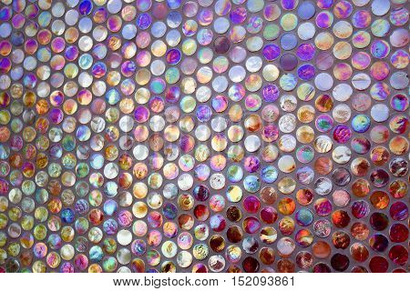 abstract pattern wall made of colored glass circles spheres