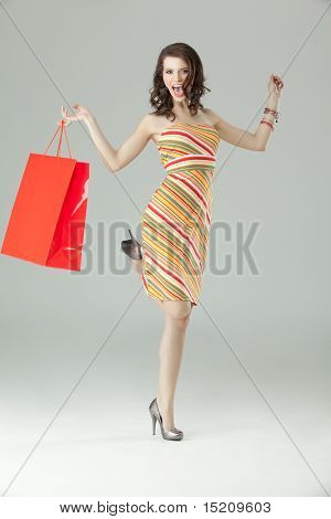 Portrait Of A Young Woman Shopping, Looking Very Happy