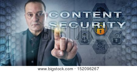 Male corporate IT consultant is touching CONTENT SECURITY onscreen. Information technology concept related to computer security standards hacking web security exploits and web applications.