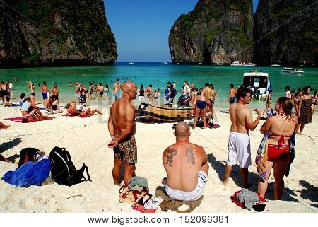 Phuket Thailand - January 16 2007: Western tourists throng the sandy beach at famed Phi Phi Island's Maya Bay