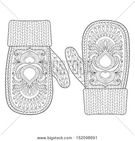 Christmas warm knitted mittens in zentangle style. Hand drawn happy Xmas decorative elements for adult coloring book. Vector illustration for New Year 2017 greeting cards, posters.
