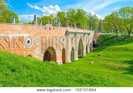 MOSCOW RUSSIA - MAY 10 2015: The Big Bridge over the Ravine in Tsaritsyno decorated with patterned fretwork columns and arches on May 10 in Moscow.