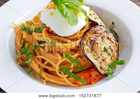 Italian Pasta with eggplants, tomato, ricotta cheese and basil.
